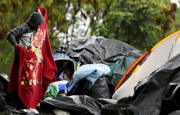 Des migrants vénézueliens dans un camp de fortune à Cali, en Colombie, le 31 juillet 2018. [Christian EscobarMora / AFP]
