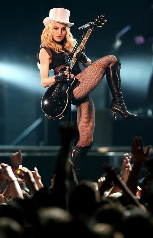 """Madonna en concert au stade du Millenium à Cardiff, le 23 août 2008 au Pays de Galles, lors de sa tournée """"Sticky and Sweet"""" [LEON NEAL / AFP/Archives]"""