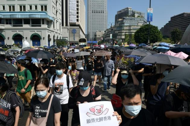 Des manifestants rassemblés dans le quartier de Tsim Sha Tsui, le 20 octobre 2019 à Hong Kong  [Ed JONES / AFP]