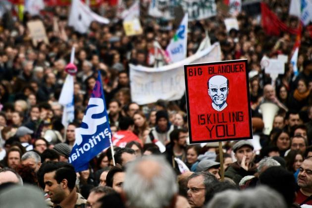 Un portrait du ministre de l'Education Jean-Michel Blanquer dans une manifestation contre la réforme des retraites à Paris, le 17 décembre 2019 [Martin BUREAU / AFP/Archives]