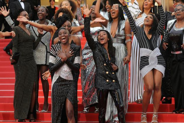 Actrices noires (et mulâtresses) manifestent pour dénoncer leur sous-représentation dans le cinéma en France, à Cannes le 16 mai 2018 [Valery HACHE / AFP]