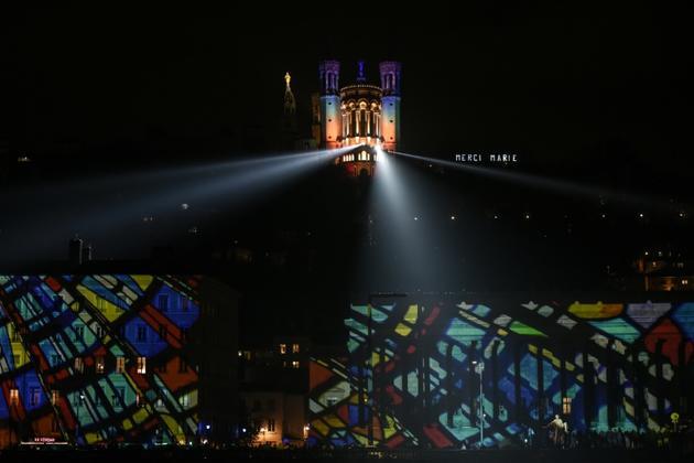 La Basilique de Fourvière illuminée lors de la Fête des Lumières, le 6 décembre 2018 à Lyon [JEAN-PHILIPPE KSIAZEK / AFP]