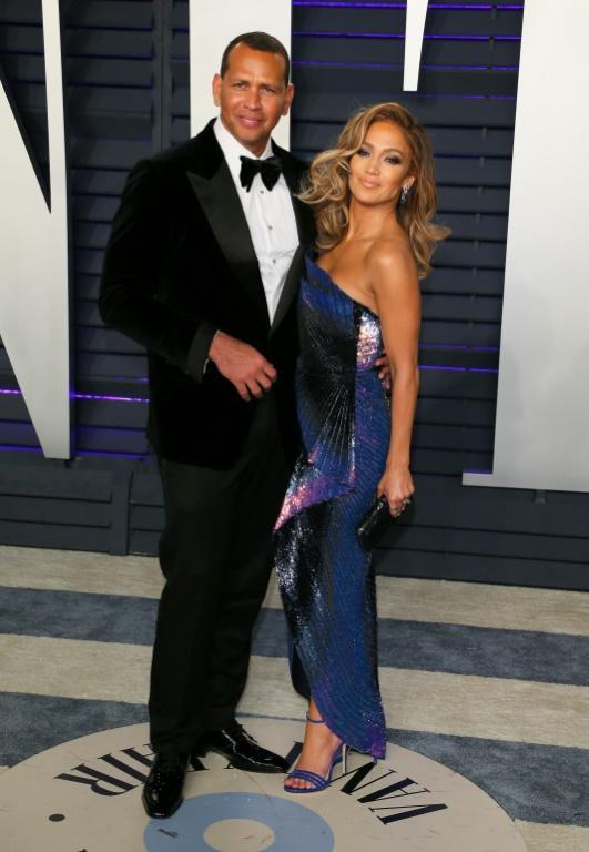 Alex Rodriguez (à gauche) et Jennifer Lopez, le 24 février 2019 à Beverly Hills [Jean-Baptiste LACROIX / AFP/Archives]