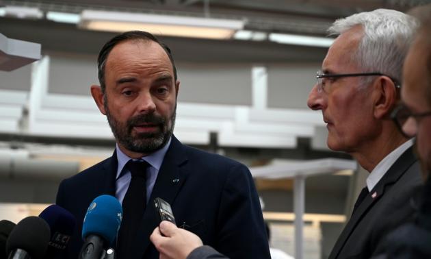 Le Premier ministre Edouard Philippe (G) et le patron de la SNCF Guillaume Pepy (D), à la gare de l'Est, le 19 octobre 2019 [DOMINIQUE FAGET / AFP]