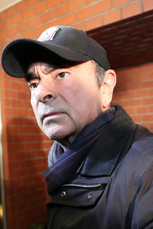Carlos Ghosn à son arrivée à sa résidence de Tokyo, le 8 mars 2019 [Behrouz MEHRI / AFP]