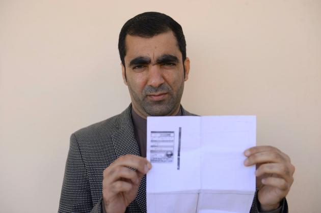 Ghulam Farooq Adil, fonctionnaire, le 15 octobre 2018 à Hérat, en Afghanistan [HOSHANG HASHIMI / AFP]