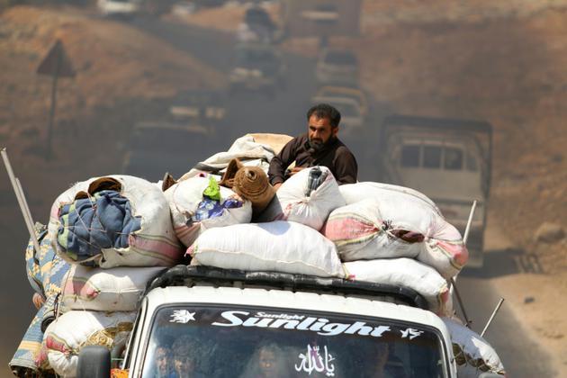 Des familles syriennes, fuiyant les combats à Idleb, arrivent dans un camp près de la frontière avec la Turquie, le 9 septembre 2018 [Aaref WATAD / AFP/Archives]