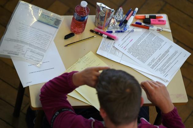 Un élève de Terminale lors de l'épreuve de philosophie le 17 juin 2019 [FREDERICK FLORIN / AFP/Archives]