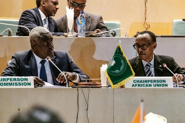 Moussa Faki (g) et Paul Kagame à la réunion de l'Union africaine sur les élections en RD Congo le 17 janvier 2019 à Addis Abeba [EDUARDO SOTERAS / AFP]