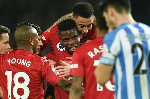 Paul Pogba fêté par ses coéquipiers avoir avoir marqué contre Huddersfield, le 26 décembre 2018 à Manchester [Oli SCARFF                           / AFP]