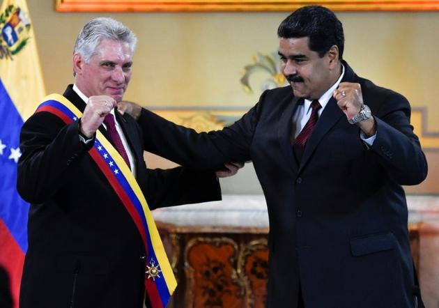 Les présidents cubain et vénézuélien, Miguel Diaz-Canel et Nicolas Maduro, le 30 mai 2018 à Caracas [Juan BARRETO / AFP/Archives]