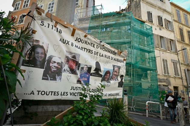 Une banderole avec les noms des victimes, photo du 25 octobre 2019 [GERARD JULIEN / AFP]