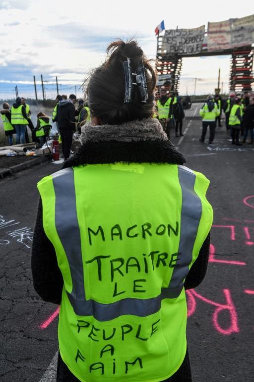 'Gilet jaune', sur la route menant au dépôt de carburant de Frontignan, le 3 décembre 2018 [PASCAL GUYOT / AFP/Archives]