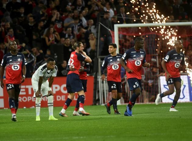 Le milieu turc de Lille Yusuf Yazici (3e en partant de la g.) vient de marquer contre Bordeaux, le 26 octobre 2019 à Villeneuve-d'Ascq [FRANCOIS LO PRESTI / AFP]