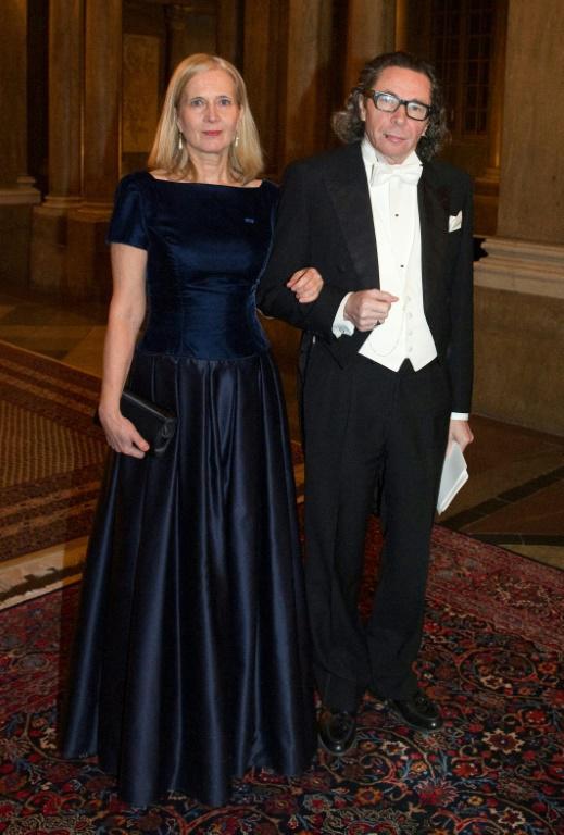 L'ancienne membre de l'Académie suédoise Katarina Frostenson et son mari, le Français Jean-Claude Arnault, le 11 décembre 2011 à Stockholm. [Henrik MONTGOMERY / TT NEWS AGENCY/AFP/Archives]