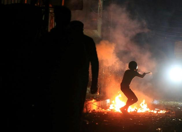 Heurts entre manifestants et forces de l'ordre dans la ville sainte chiite de Kerbala, le 29 novembre 2019  [Mohammed SAWAF / AFP]