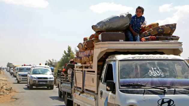 Des Syriens quittent les zones de la province d'Idleb menacées par une attaque des armées syrienne et russe, le 6 septembre 2018. [Aaref WATAD / AFP]