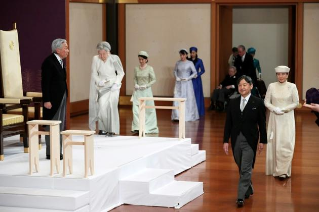 L'empereur Akihito (G), son épouse l'impératrice Michiko (2e G), le prince héritier Naruhito (2e D), son épouse Masako (D), et d'autres membres de la famille royale japonaise, lors de la cérémonie d'abdication d'Akihito à Tokyo le 30 april 2019. [STR / Japan Pool/AFP]