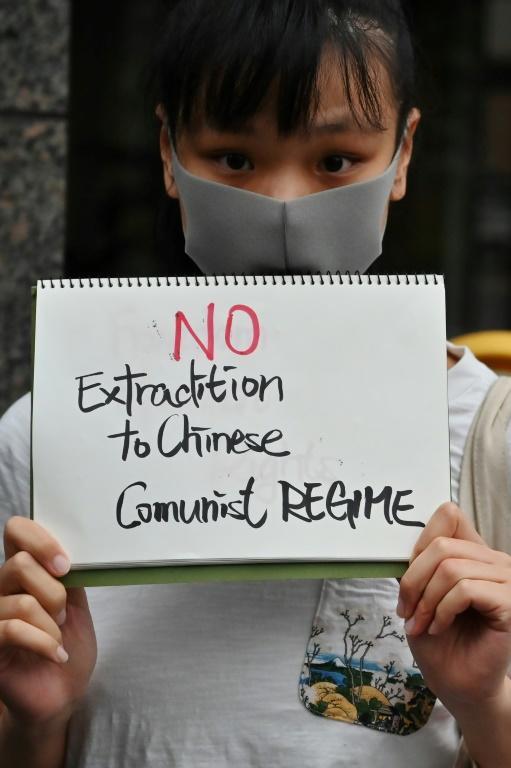 Lors de la manifestation du 9 juin 2019 à Hong Kong, organisée pour protester contre un projet de loi d'extradition vers la Chine continentale [Charly TRIBALLEAU / AFP]