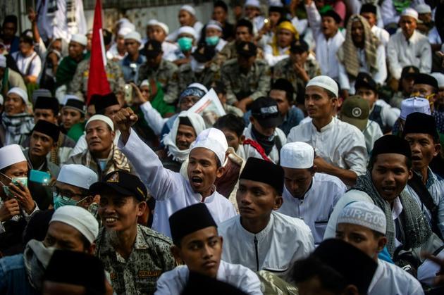 Des partisans de Prabowo Subianto lors d'une manifestation à Surabaya le 17 mai 2019 [Juni Kriswanto / AFP/Archives]