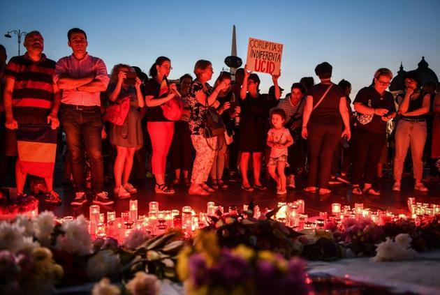 Veillée le 27 juillet 2019 à Bucarest en mémoire d'Alexandra, une fillette dont l'enlèvement et le meurtre ont profondément ému le pays provoquant le limogeage du chef de la police [Daniel MIHAILESCU / AFP]