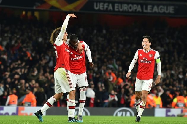 Nicolas Pépé, héros d'Arsenal après soin doublé sur coup franc qui permet aux Gunners de s'imposer face à Guimaraes, le 24 octobre 2019 à Londres [Glyn KIRK                   / AFP]