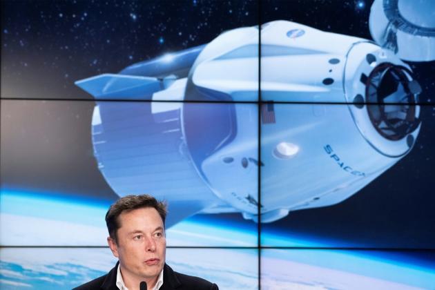 Elon Musk lors d'une conférence de presse après le lancement réussi de la capsule Crew Dragon, le 2 mars 2019 [Jim WATSON / AFP]