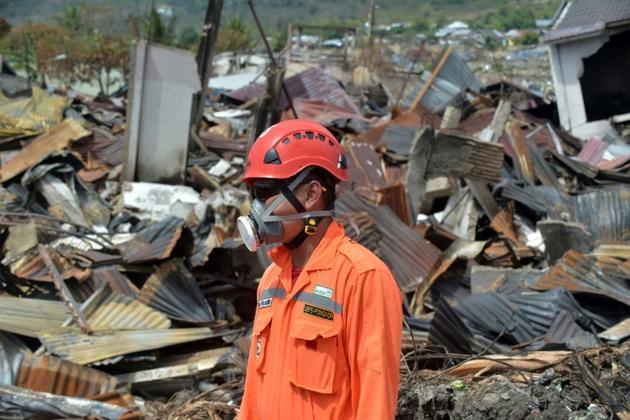 Opération de secours à Balaroa, une zone de Palu fortement touchée par le séisme et le tsunami, le 8 octobre 2018 en Indonésie [ADEK BERRY / AFP]