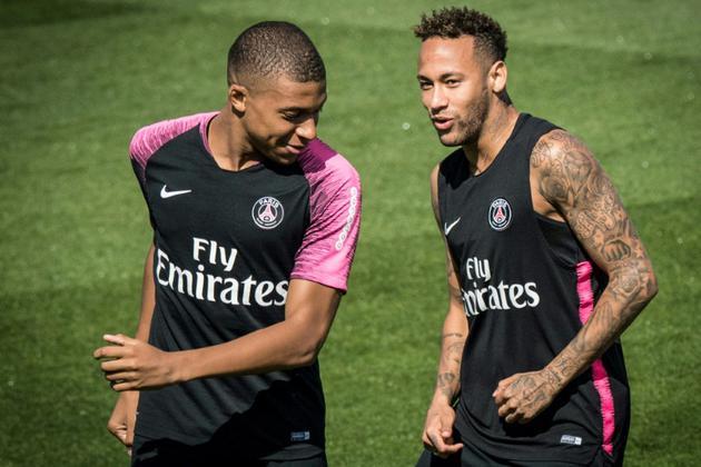 Les attaquants du PSG Kylian Mbappé et Neymar, lors d'un entraînement le 11 août 2018 à Saint-Germain-en-Laye [GERARD JULIEN / AFP]