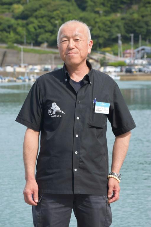 Yoshifumi Kai, qui préside une association de pêcheurs, se tient sur le port de Taiji, le 17 juin 2019. [JIJI PRESS / JIJI PRESS/AFP/Archives]