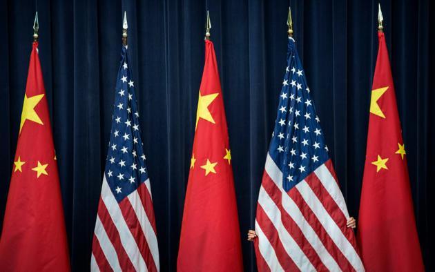 """Pékin a dénoncé mercredi le """"volte-face"""" de son partenaire américain sur la question des droits de douanes [Brendan SMIALOWSKI / AFP/Archives]"""