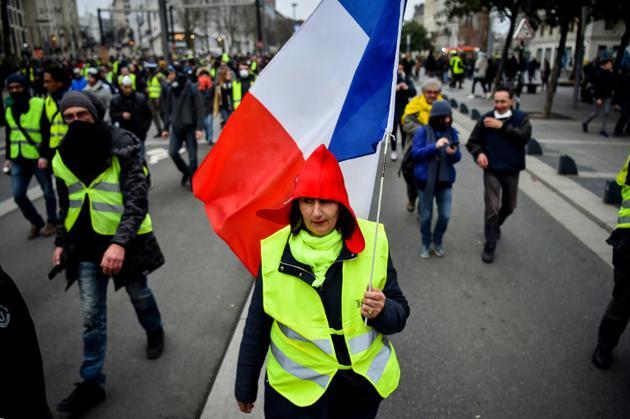 """Une manifestante des """"gilets jaunes"""" lors d'un rassemblement, le 12 janvier 2019 à Nantes  [LOIC VENANCE / AFP]"""
