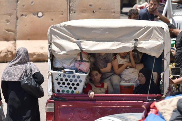 Des déplacés par l'offensive du régime dans la province méridionale de Deraa en Syrie sur le chemin du retour, le 11 juillet 2018 [Mohamad YUSUF / AFP]