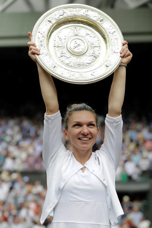 La Roumaine Simona Halep remporte la finale de Wimbledon le 13 juillet 2019 [Ben Curtis / POOL/AFP]