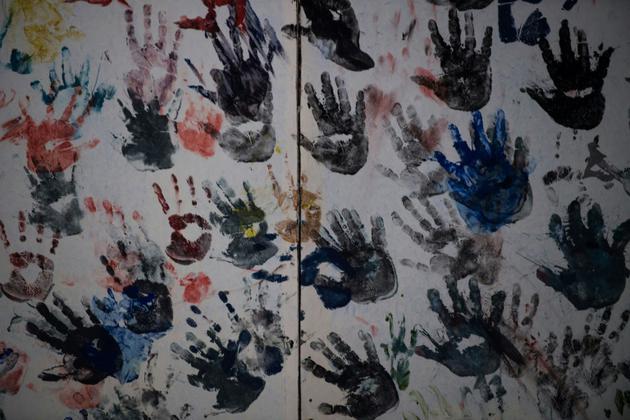 Graffiti dans un immeuble squatté de la banlieue de Sao Paulo au Brésil, le 14 mai 2018 [NELSON ALMEIDA / AFP/Archives]