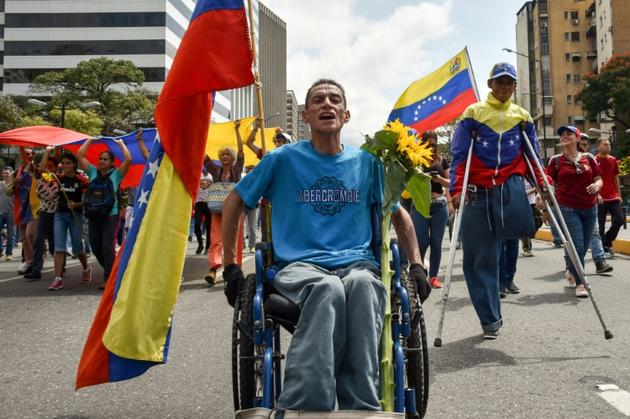 Des partisans du président autoproclamé vénézuelien Juan Guaido manifestent à Caracas le 9 mars 2019 [YURI CORTEZ                          / AFP]