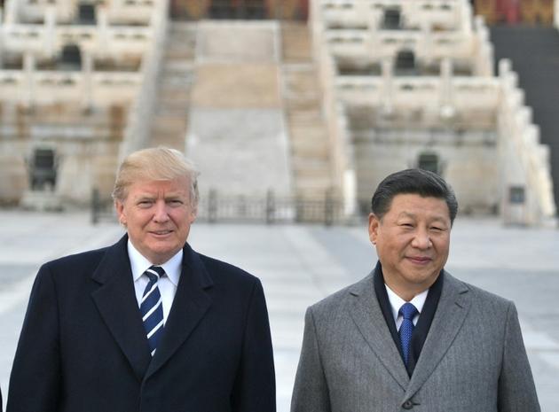 Les présidents Donald Trump et Xi Jinping à Pékin le 8 novembre 2017 [Jim WATSON / AFP/Archives]