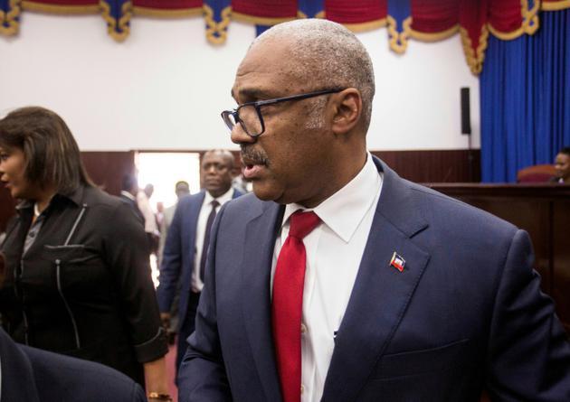 Le Premier ministre haïtien Jack Guy Lafontant arrive à la Chambre des députés à Port-au-Prince le 14 juillet 2018 [Pierre Michel Jean / AFP]