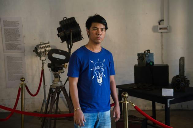 Le cinéaste Maung Okkar, fondateur d'un projet pour restaurer les vieux films birmans, le 12 avril 2018 à Rangoun [Phyo Hein KYAW / AFP Photo]