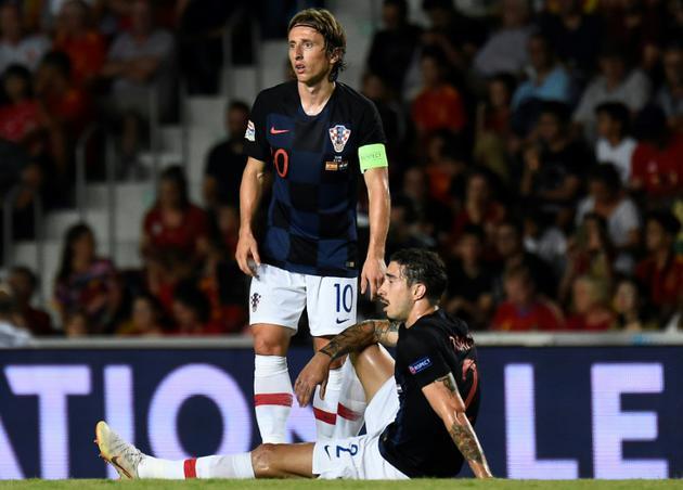 Le Croate Luka Modric (g) lors de la défaite 6-0 face à l'Espagne en 2e journée de Ligue des nations le 11 septembre 2018 [JOSE JORDAN / AFP]