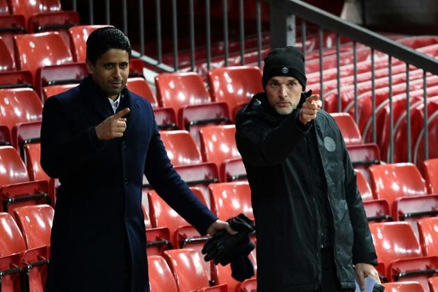 Le président Nasser al-Khelaïfi et son coach Thomas Tuchel assistant à une séance d'entraînement du PSG à Old Trafford, le 11 février 2019 [FRANCK FIFE / AFP/Archives]