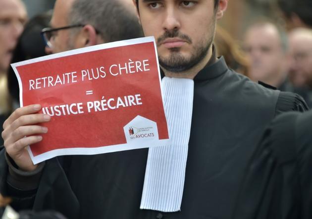Un avocat mobilisé contre la réforme des retraites à Toulouse, le 9 janvier 2020 [Pascal PAVANI                        / AFP]