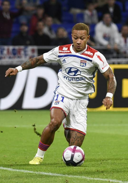 Lyon et son avant-centre Memphis Depay restent sur une défaite à domicile devant l'OGC Nice, le 31 août 2018  [PHILIPPE DESMAZES / AFP/Archives]