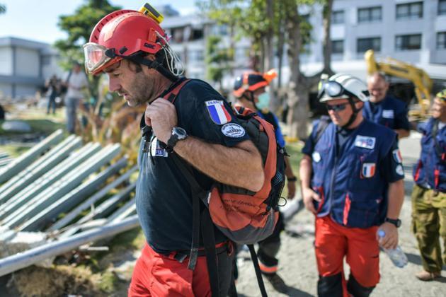 Des sauveteurs de l'ONG française Pompiers de l'urgence internationale<br />à Palu, sur l'île des Célèbes, le 5 octobre 2018 [MOHD RASFAN / AFP]