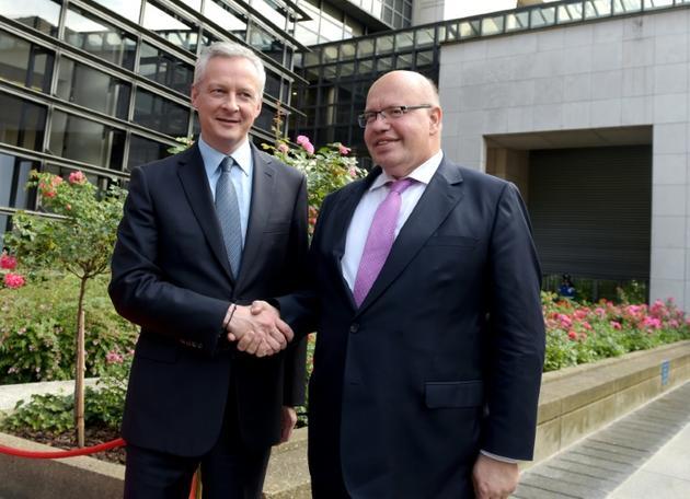 Les ministres de l'Economie français et allemand, Bruno Le Maire (à gauche) et Peter Altmaier, le 11 juillet 2018 à Paris [ERIC PIERMONT / AFP/Archives]