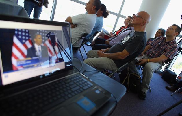 Des personnes assistent à un débat de Barack Obama, le 29 janvier 2013 à Miami [Joe Raedle / Getty Images/AFP/Archives]