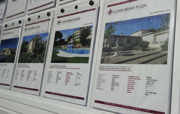 Des annonces immobilières en Espagne, à Platja d'Aro [Josep Lago / AFP/Archives]