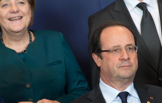 La chancelière allemande Angela Merckel et François Hollande, le 22 mai 20113 à Bruxelles [Bertrand Langlois / AFP]