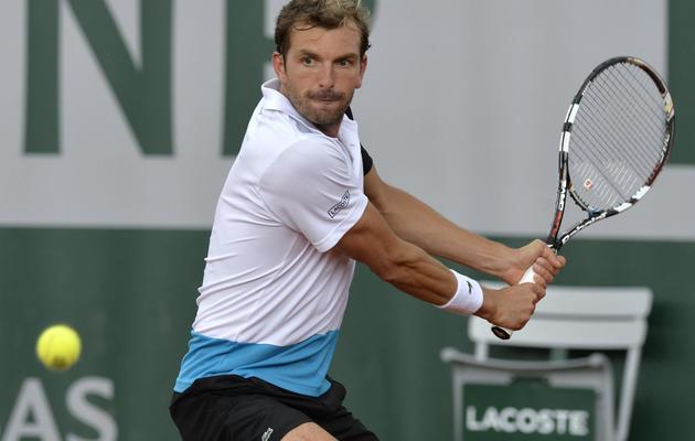 Julien Benneteau, lors de sa rencontre du 2e tour de Roland-Garros contre Tobias Kamke, le 29 mai 2013 à Paris [Miguel Medina / AFP]