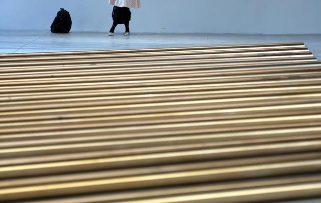 Une personne visite une exposition de la 55e Biennale d'art, le 29 mai 2013 à Venise [Gabriel Bouys / AFP]